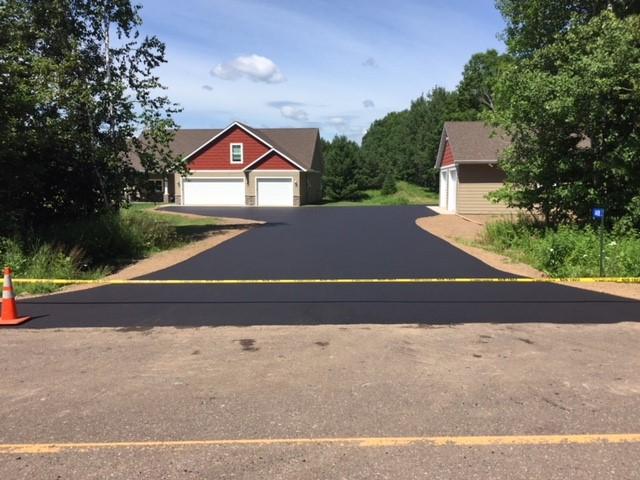 Fresh blacktop pavement on a residential driveway
